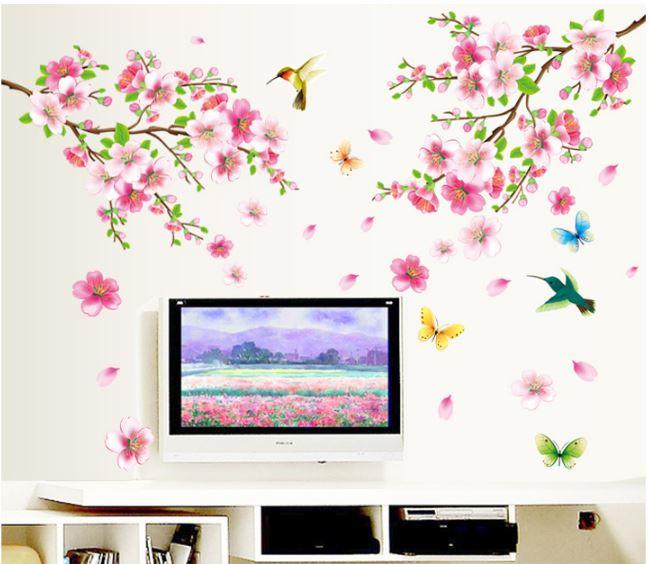 Muursticker tak roze bloemen met Vogels